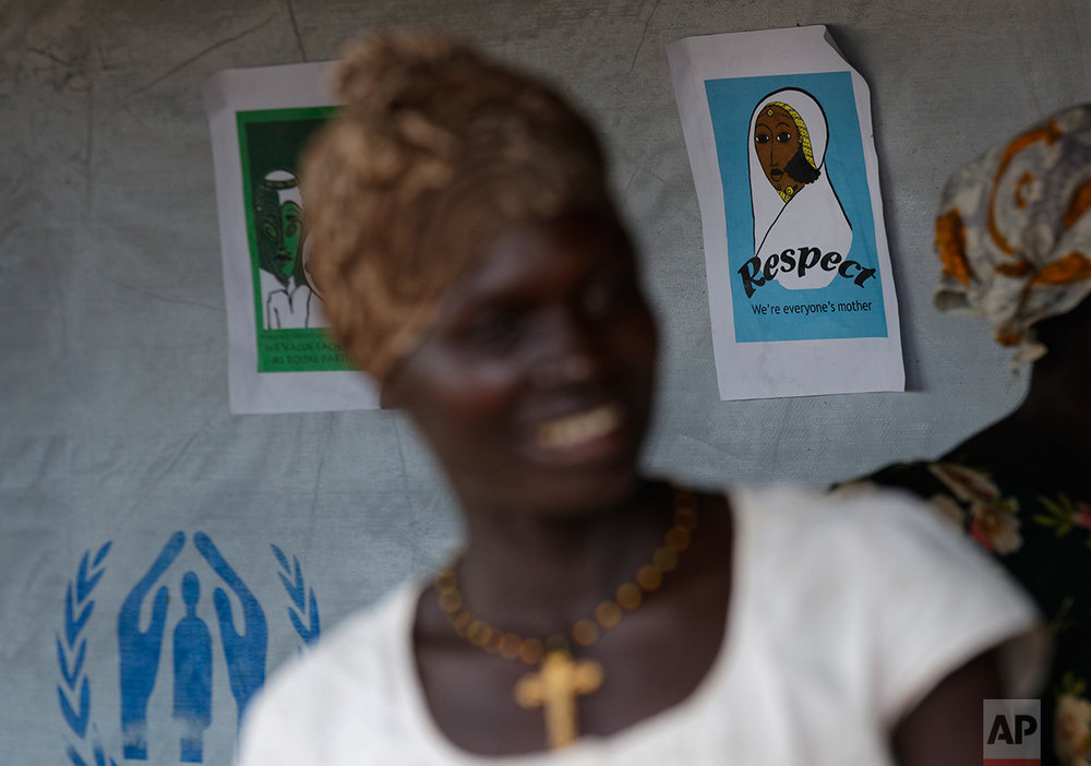 In this photo taken Saturday, June 3, 2017, a sign promoting knowledge of gender issues hangs on the wall of a women's center for South Sudanese refugees who experienced sexual or gender-based violence, run by the aid group International Rescue Committee, in Bidi Bidi, Uganda.  (AP Photo/Ben Curtis)