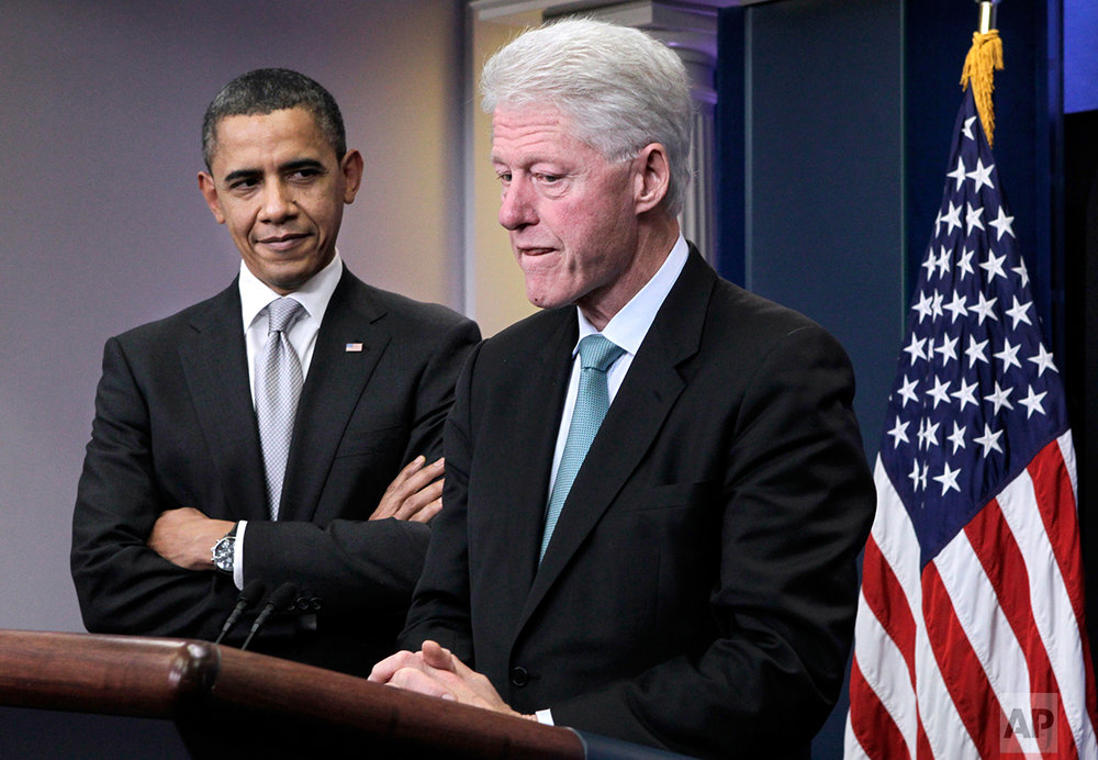 President Barack Obama looks on as former President Bill Clinton pauses while speaking in the briefing room of the White House in Washington, Friday, Dec. 10, 2010. (AP Photo/J. Scott Applewhite)