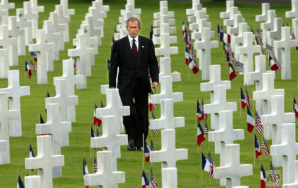 President Bush observes Memorial Day, Monday, May 27, 2002, with a visit to the Normandy American Cemetery in Colleville-sur-Mer, France, home to the graves of 9,387 men and women killed in the World War II liberation of Europe. It was at the nearby beaches of Normandy in northwestern France where Allied forces broke through Hitler's fortifications 58 years ago to begin the end of World War II. (AP Photos/J. Scott Applewhite)