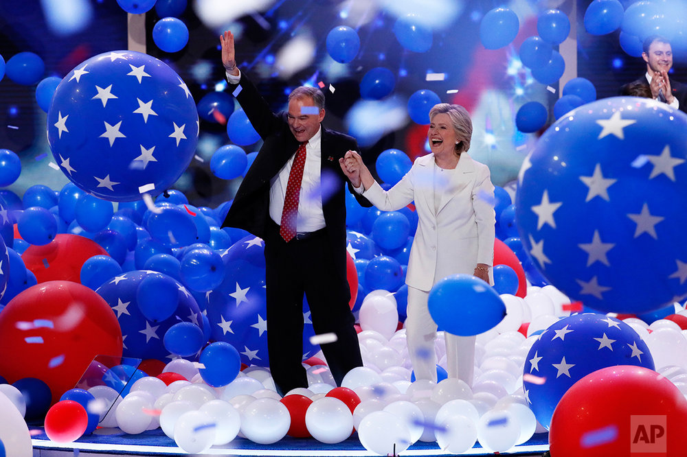 Democratic vice presidential nominee Sen. Tim Kaine, D-Va., and Democratic presidential nominee Hillary Clinton walk through the falling balloons during the final day of the Democratic National Convention in Philadelphia, July 28, 2016. (AP Photo/J. Scott Applewhite)