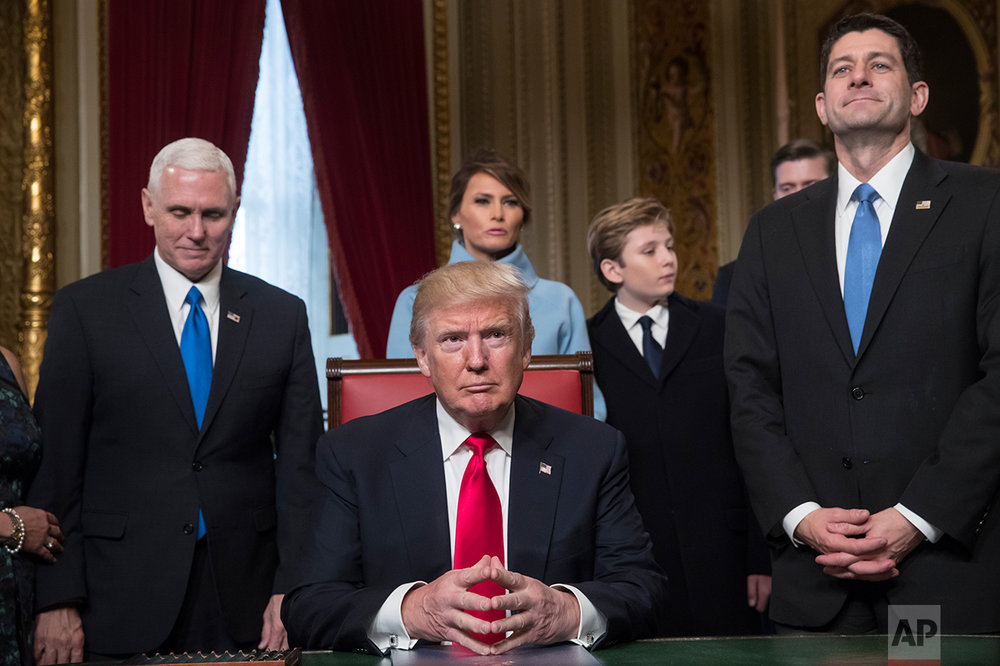 President Donald Trump is joined by the Congressional leadership and his family before formally signing his cabinet nominations into law, in the President's Room of the Senate, at the Capitol in Washington, Friday, Jan. 20, 2017. From left are Vice President Mike Pence, the president's wife Melania Trump, their son Barron Trump, and Speaker of the House Paul Ryan, R-Wis. (AP Photo/J. Scott Applewhite)