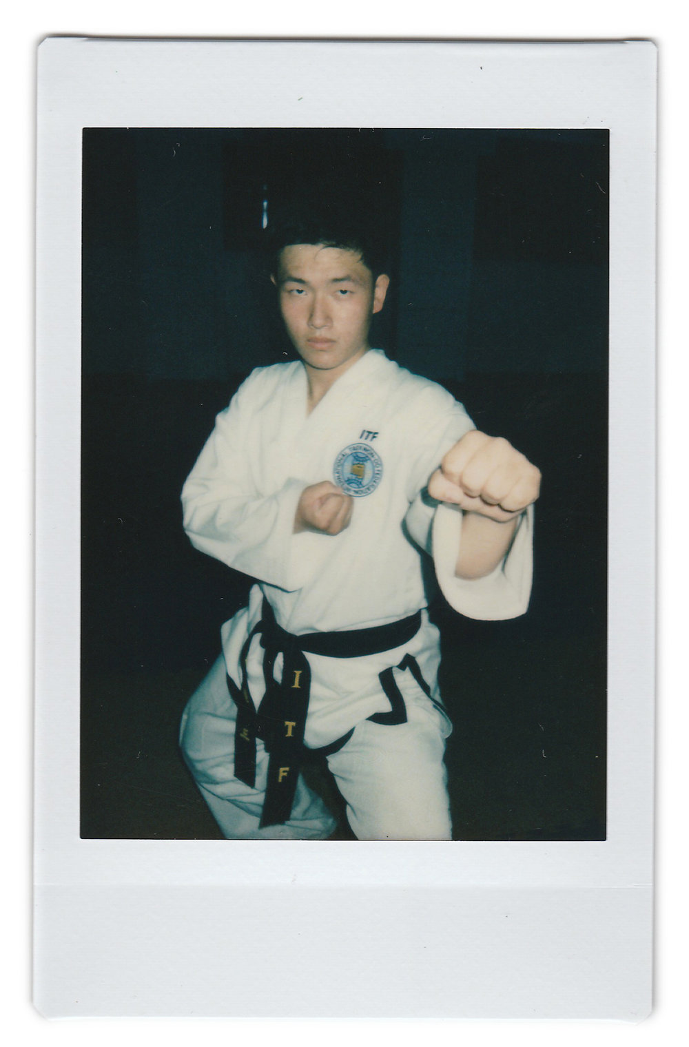 "In this April 17, 2017, photo made with an instant camera, Won Dae Chol, 20, poses for a portrait at the Taekwando Palace in Pyongyang, North Korea. When asked what's important to them, North Koreans might talk about working hard, or doing well at sports, or having a big family, but leader Kim Jong Un is never far from the conversation. His motto: ""I want to win medals in this sport to please our leader Kim Jong Un."" (AP Photo/Wong Maye-E)"