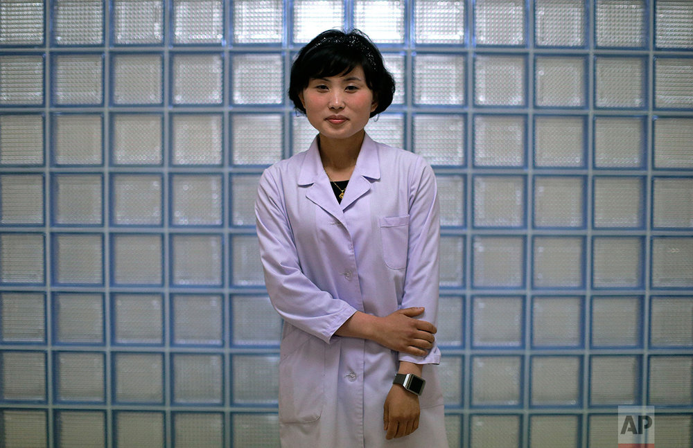 "In this May 7, 2016, photo, Kim Una, 23, studying to be an obstetrician at the Pyongyang Maternity hospital, poses for a portrait in Pyongyang, North Korea. She enjoys the work because it is about ""bringing new life into the world."" She hopes to ""meet a good man and have five children with him."" (AP Photo/Wong Maye-E)"