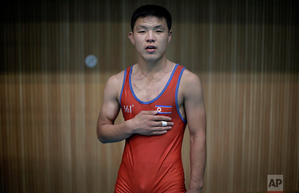 In this Aug. 29, 2014, photo, North Korean wrestler Hwang Myong Hyok, 19, poses for a portrait in Pyongyang, North Korea. Hwang has been wrestling for four years. (AP Photo/Wong Maye-E)