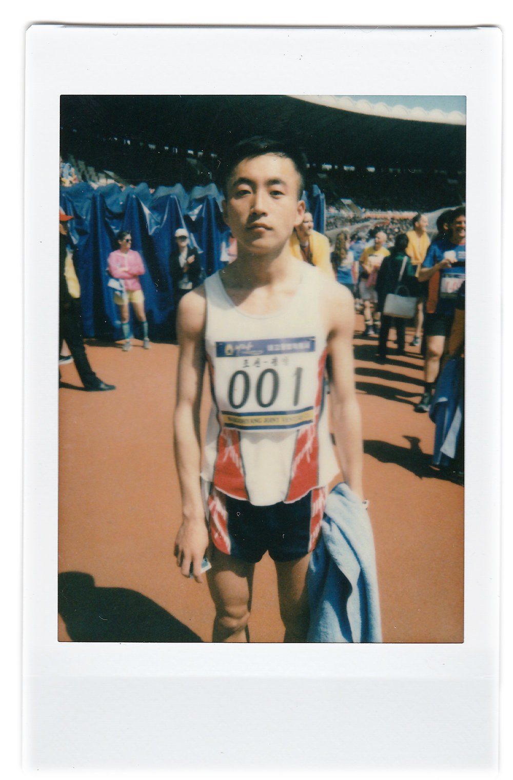 "In this April 9, 2017, photo made with an instant camera, Pak Chol, 27, a professional long distance runner, poses for a portrait after winning the Pyongyang marathon in Pyongyang, North Korea. Pak has won three marathons in his life. His motto: ""I want to please leader Kim Jong Un through my sporting successes."" (AP Photo/Wong Maye-E)"