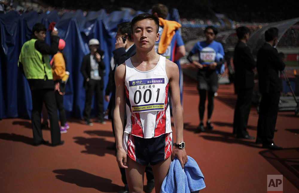 "In this April 9, 2017, photo, Pak Chol, 27, a professional long distance runner, poses for a portrait after winning the Pyongyang marathon in Pyongyang, North Korea. Pak has won three marathons in his life. His motto: ""I want to please leader Kim Jong Un through my sporting successes."" (AP Photo/Wong Maye-E)"