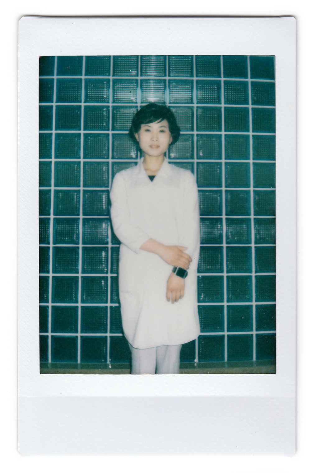 "In this May 7, 2016, photo made with an instant camera, Kim Una, 23, studying to be an obstetrician at the Pyongyang Maternity hospital, poses for a portrait in Pyongyang, North Korea. When asked what's important to them, North Koreans might talk about working hard, or doing well at sports, or having a big family, but leader Kim Jong Un is never far from the conversation. She enjoys the work because it is about ""bringing new life into the world."" She hopes to ""meet a good man and have five children with him."" (AP Photo/Wong Maye-E)"