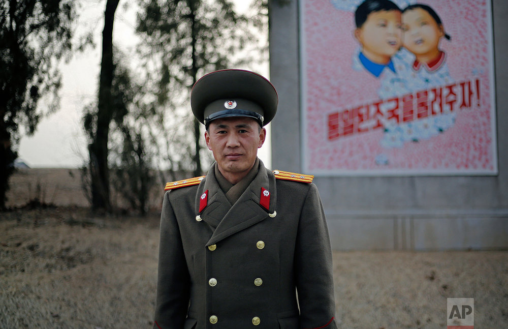 In this Feb. 22, 2016, photo, North Korean People's Army Lt. Col. Nam Dong Ho poses for a portrait at the entrance to the Demilitarized Zone (DMZ) on the North Korean side. (AP Photo/Wong Maye-E)