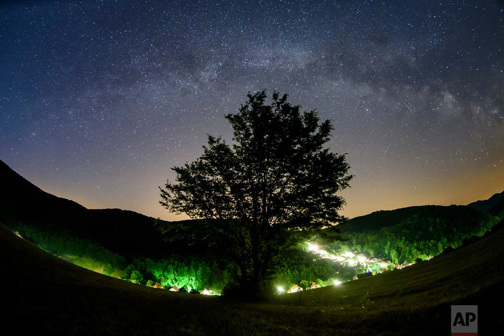 The Milky Way arcs in the summer night sky seen near Repashuta, 170 kilometers (105 miles) northeast of Budapest, Hungary, on Thursday, June 15, 2017. (Peter Komka/MTI via AP)