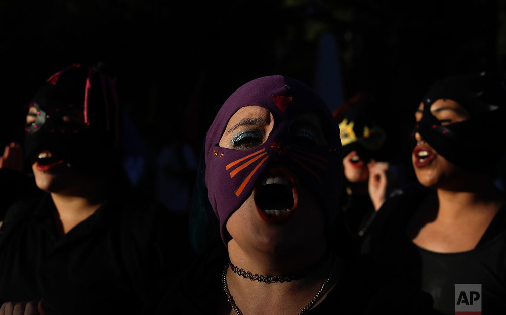 In this March 8, 2017 photo, women shout as they march on International Women's Day in Neuquen, Argentina. One in three women worldwide have experienced physical or sexual violence, according to the United Nations. In most countries, fewer than 40 percent of those abused sought help of any sort. (AP Photo/Natacha Pisarenko)