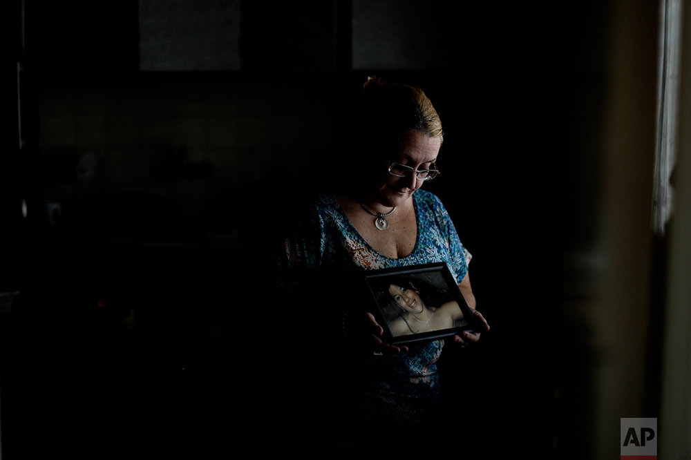 "In this Feb. 13, 2017 photo, Marcela Morera holds a picture of her daughter Julieta Mena in Buenos Aires, Argentina. Julieta was beaten to death by her boyfriend on Oct. 11, 2015 when she was two months pregnant at age 22. He was sentenced to life in prison. ""No one will give me back my daughter, or her baby,"" said Morera, who now works to help victims of gender violence. (AP Photo/Natacha Pisarenko)"