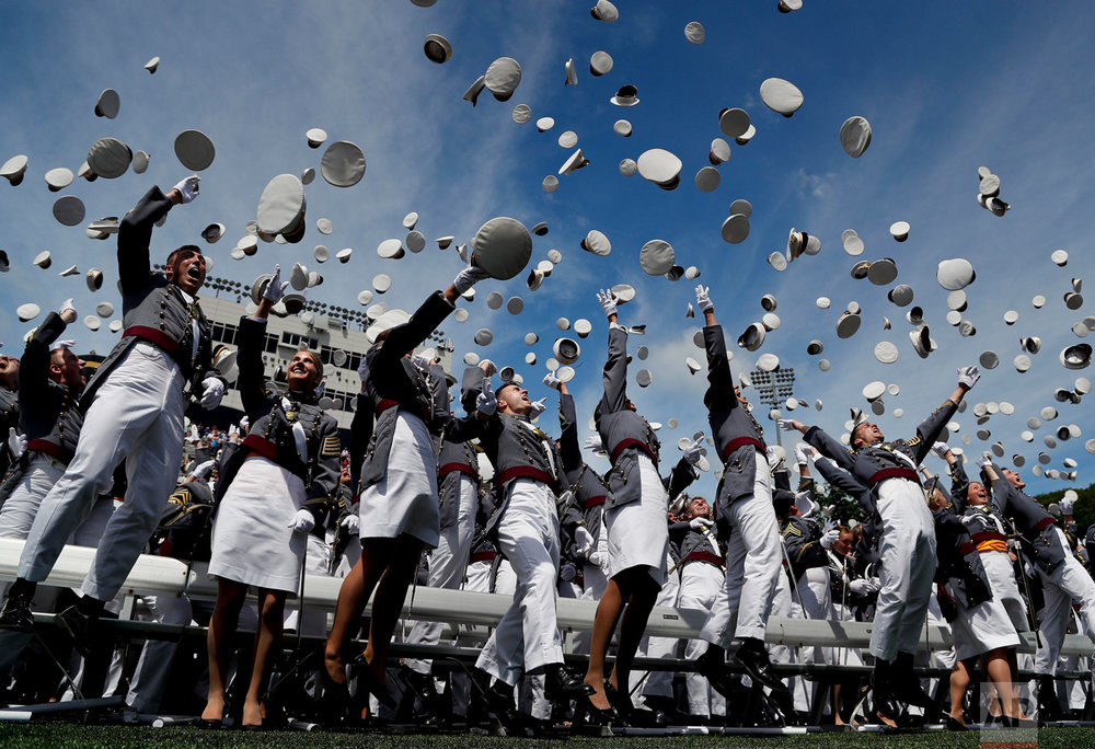Cadets toss their caps into the air after graduating from the United States Military Academy, Saturday, May 27, 2017, in West Point, N.Y. Nine Hundred and thirty six cadets received their diplomas, most of whom will be commissioned as second lieutenants in the army. (AP Photo/Julie Jacobson)