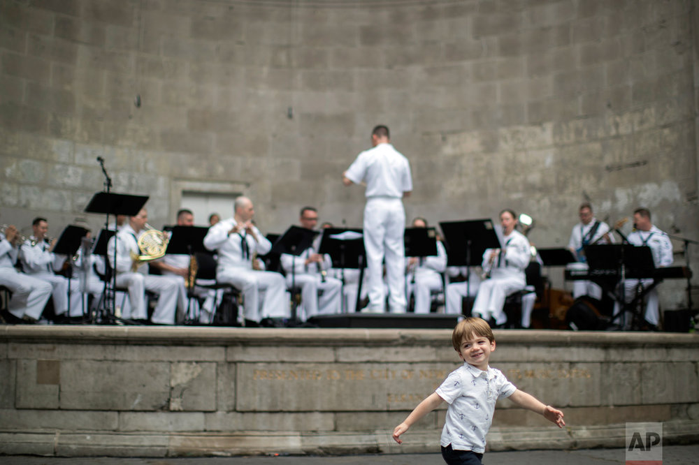 A child dances as the Navy Band Northeast performs at the Naumburg Bandshell ahead of the 2017 Fleet Week New York, Tuesday, May 23, 2017 in Central Park. Approximately 3,700 Sailors, Marines and Coast Guardsmen will partake in the weeklong celebration which kicks off Wednesday with Parade of Ships sailing up the Hudson River from the New York Harbor. (AP Photo/Mary Altaffer)