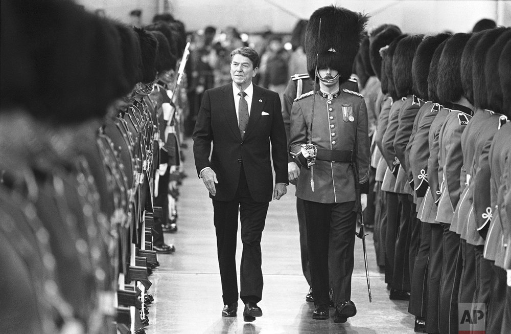 President Ronald Reagan reviews the honor guard on Sunday, March 17, 1985 during arrival ceremonies at the Quebec City Airport. The ceremonies were held inside a hangar due to the extreme cold. President Reagan flew to Canada for two days of meetings with Prime Minister Brian Mulroney. (AP Photo/Scott Applewhite)