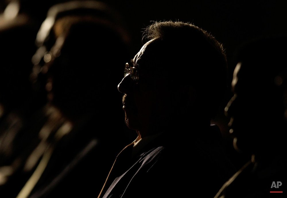 Cuba's President Raul Castro, center, attends the opening ceremony of the 19th International Book Fair in Havana, Thursday, Feb. 11, 2010. (AP Photo/Franklin Reyes)