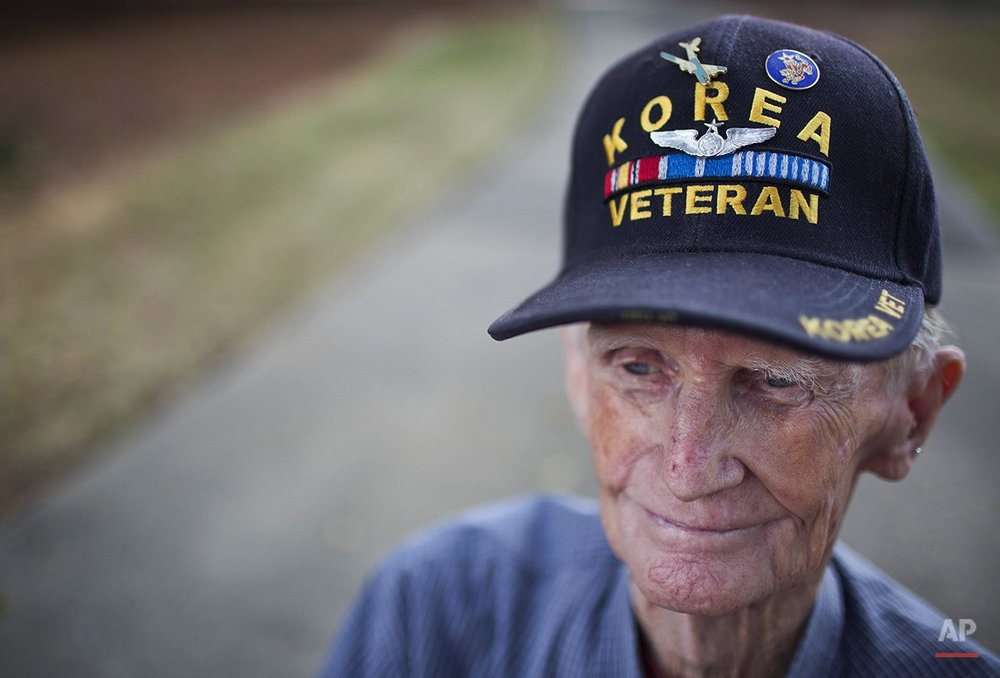A retired Korean War Veteran, Wheeler Forshee, sits and watches the Veterans Day parade Tuesday, Nov. 11, 2014, in Montgomery, Ala.(AP Photo/Brynn Anderson)