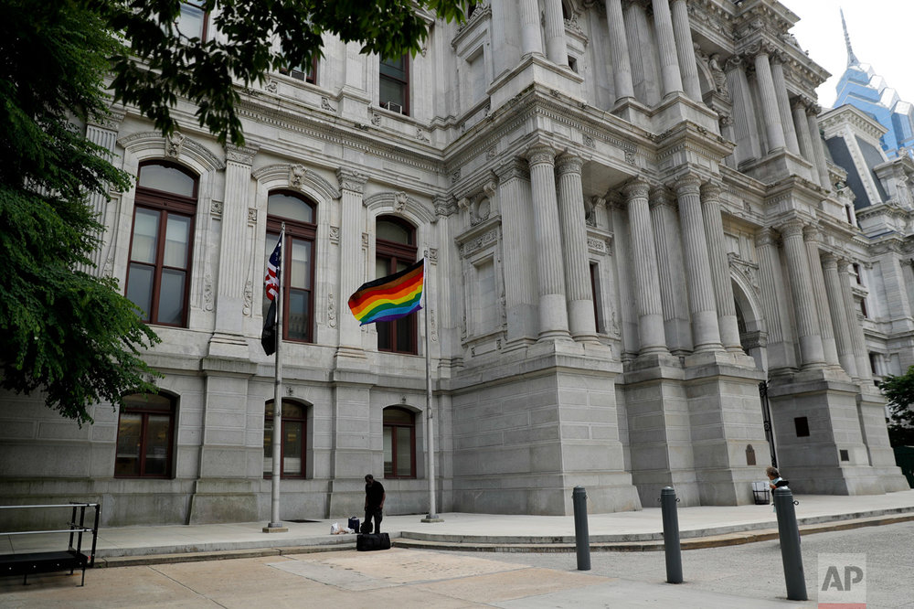 In this Monday, June 19, 2017, Philadelphia's altered gay pride flag is seen outside City Hall. (AP Photo/Matt Slocum)