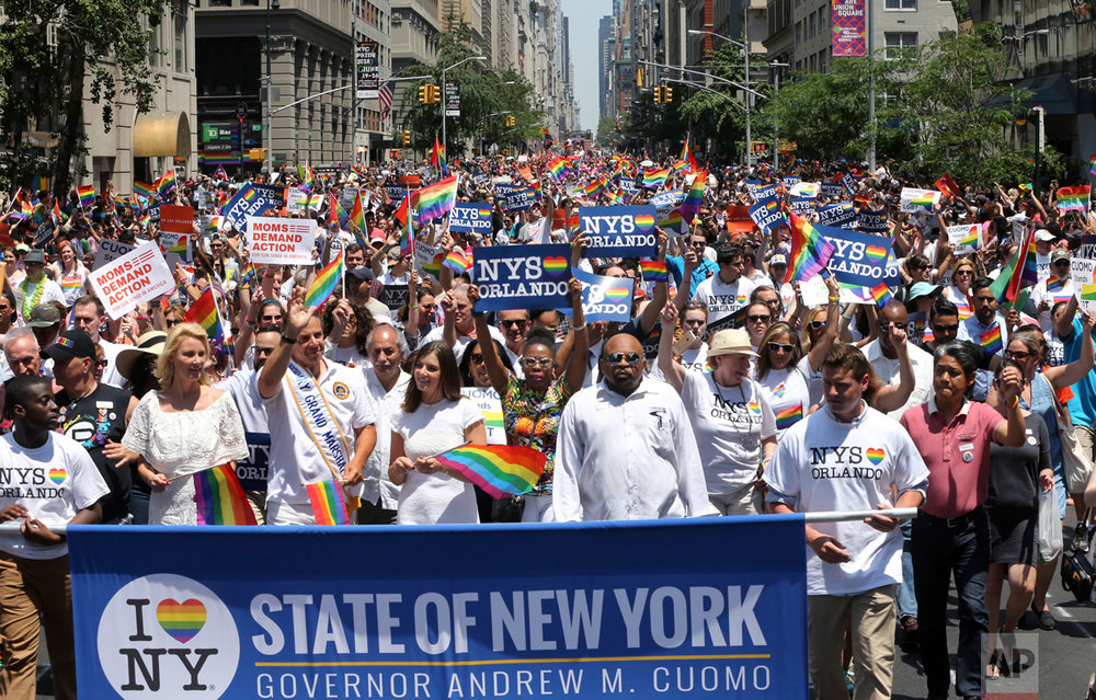 In this June 26, 2016 photo, marchers filled the street during New York City's pride parade. The annual pride parade takes place on Sunday, June 25, 2017, amid protests by black and brown LGBT people saying increasingly corporate pride celebrations prioritize the experiences of gay white men and ignore the issues continuing to face black and brown LGBT people. (AP Photo/Mel Evans)