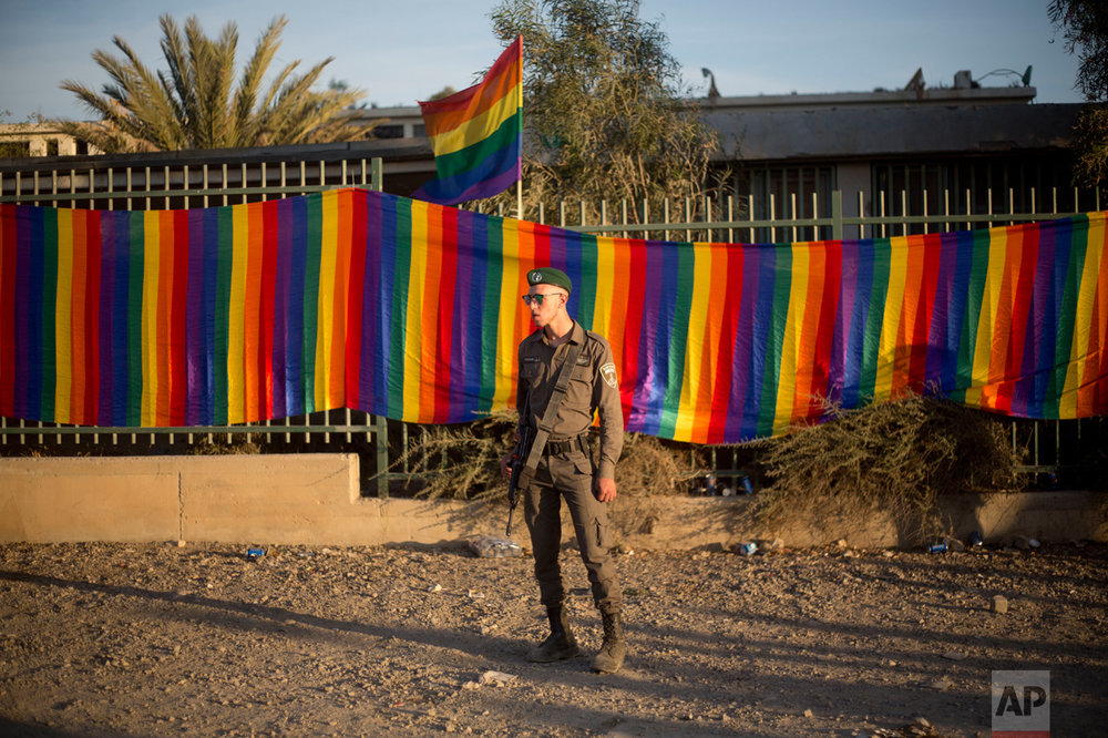 An Israeli border police officer stands guards as people participate in the first Gay Pride Parade in Beersheba, Israel, Thursday, June 22, 2017. Around 3500 people marched. (AP Photo/Ariel Schalit)
