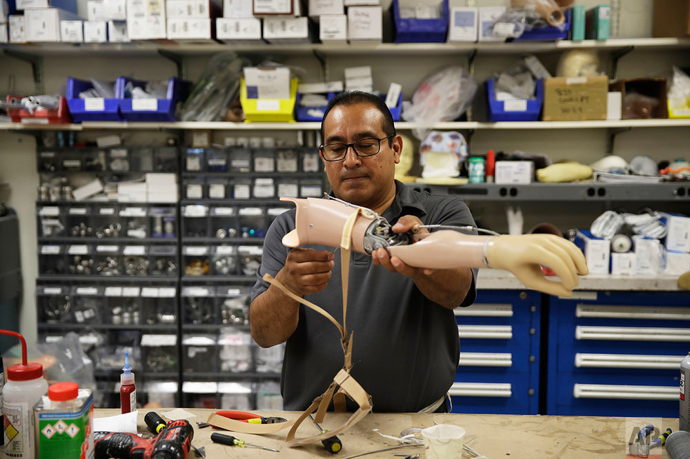 Luis Velasquez, works during a prosthetic limb fitting at Shriners Hospital for Children in Philadelphia, Tuesday, May 30, 2017. (AP Photo/Matt Rourke)