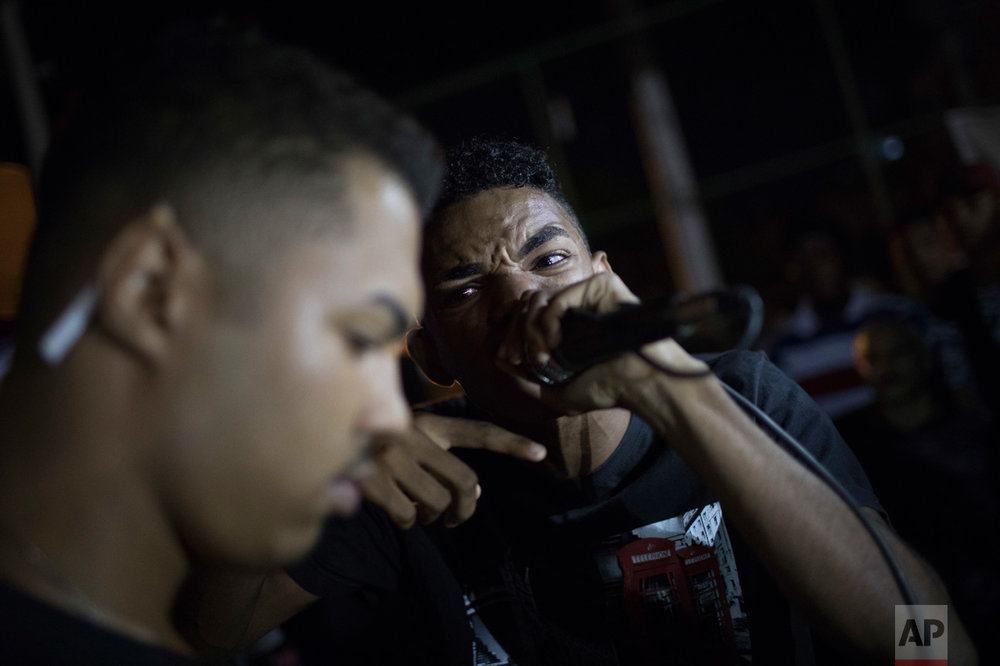In this June 8, 2017 photo, rap artists engage in a rap battle in the City of God slum of Rio de Janeiro, Brazil. (AP Photo/Leo Correa)