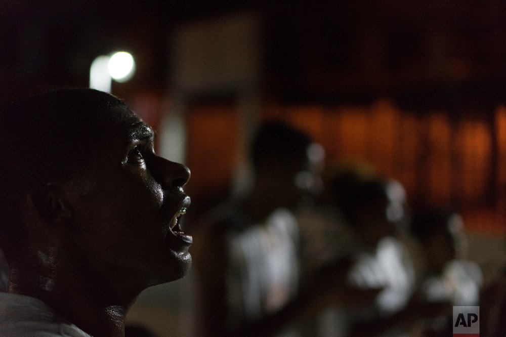 In this June 5, 2017 photo, Mike Leonardo de Jesus da Silva, 24, sings during a Copeira class at a community center kept open only by the extraordinary effort of residents of the City of God slum in Rio de Janeiro, Brazil. (AP Photo/Leo Correa)