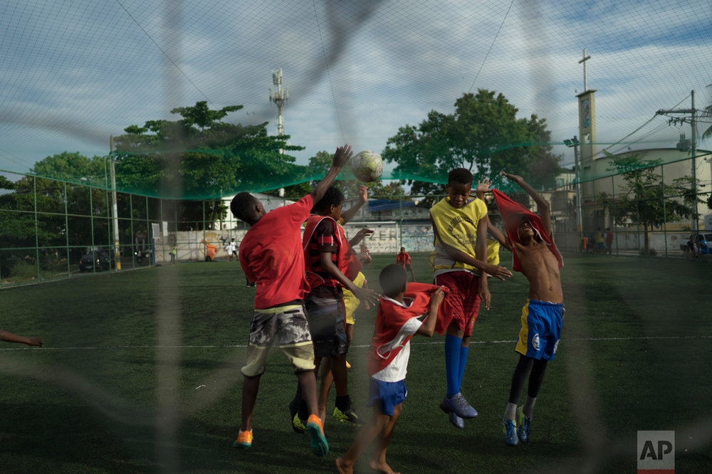 In this June 5, 2017 photo, youths play soccer in the City of God slum of Rio de Janeiro, Brazil.  (AP Photo/Leo Correa)