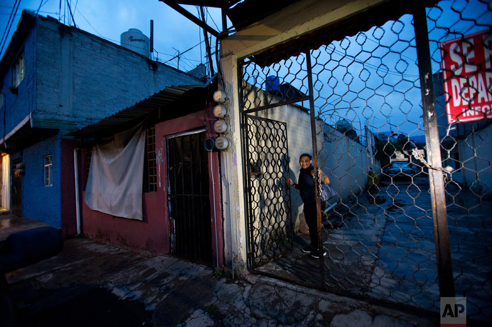 In this June 27, 2017 photo, Honduran refugee Laura Maria Cruz Martinez, 40, arrives home from work to the building where she, her three children and her niece share a two-bedroom apartment with a Salvadoran refugee and her daughter, in the Iztapalapa district of Mexico City. (AP Photo/Rebecca Blackwell)