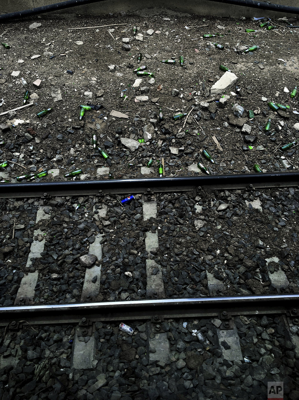In this May 17, 2017 photo, beer bottles and soda cans lay along the railing of a metro station, in Cairo, Egypt. (AP Photo/Nariman El-Mofty)