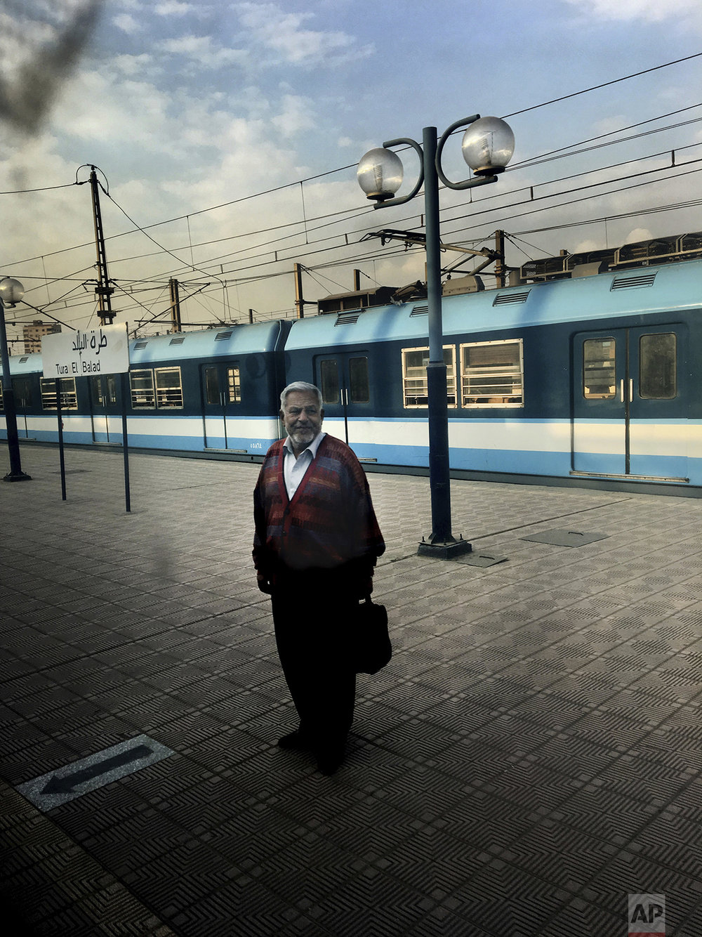 In this Feb. 1, 2017 photo, a man waits for a train at Tura El Balad metro station, in Cairo, Egypt. (AP Photo/Nariman El-Mofty)