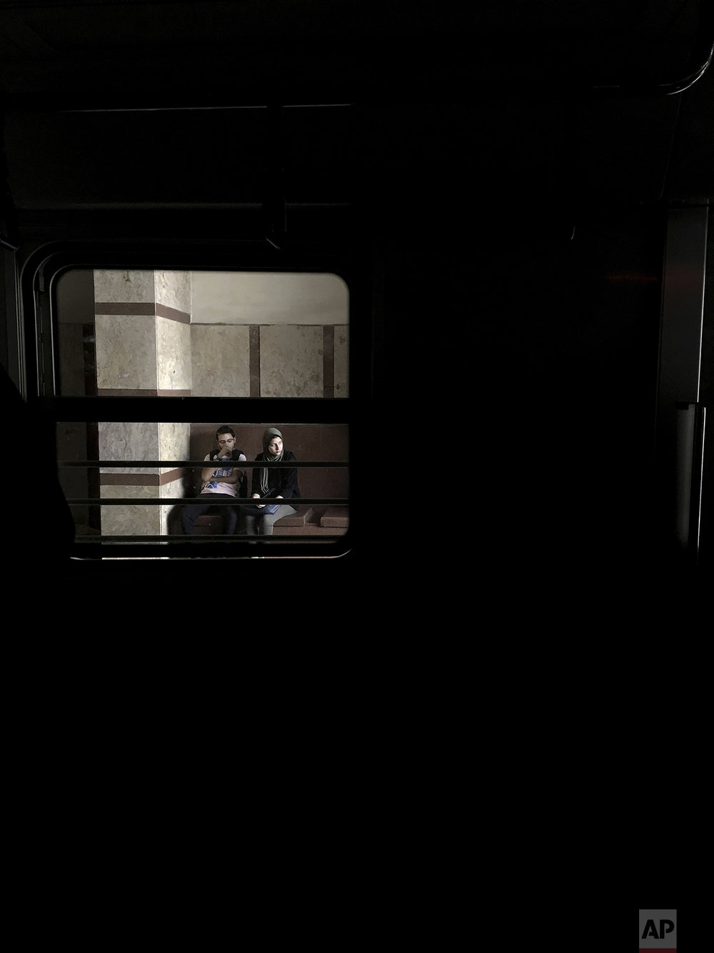 In this May 17, 2017 photo, people wait for a train at a metro station, in Cairo, Egypt. (AP Photo/Nariman El-Mofty)