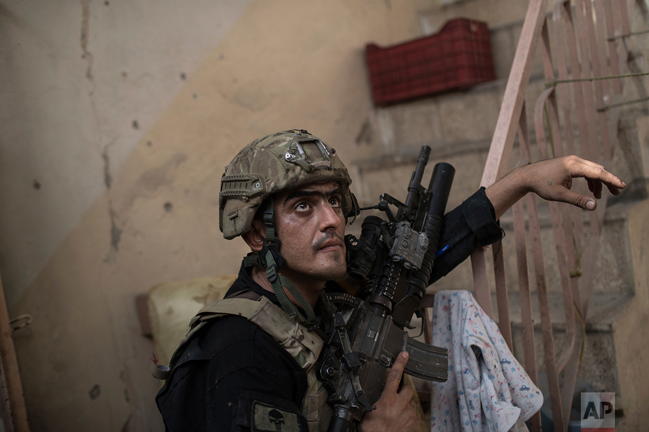 An Iraqi Special Forces soldiers watches for Islamic State militants as they continue their advance in the Old City of Mosul, Iraq, Monday, July 3, 2017. (AP Photo/Felipe Dana)