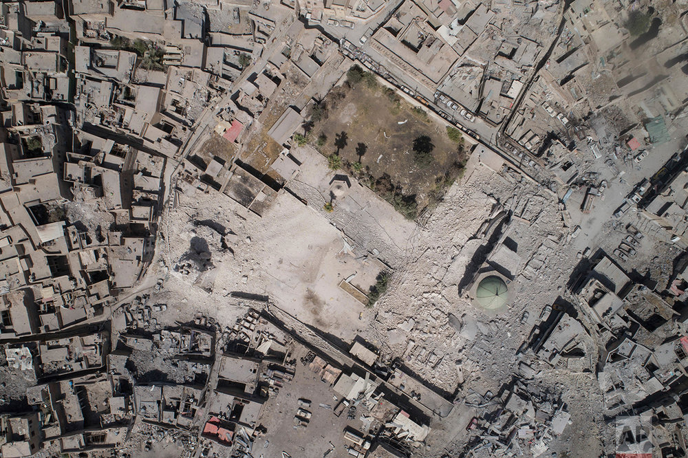 Aerial view of the destroyed al-Nuri mosque during fighting between Iraqi security forces and Islamic State militants in the Old City of Mosul, Iraq, Wednesday, June 28, 2017. (AP Photo/Felipe Dana)