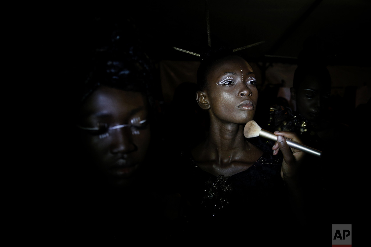 A model has her make up done backstage during Dakar Fashion Week in the Senegalese capital, Friday June 30, 2017. (AP Photo/Finbarr O'Reilly)