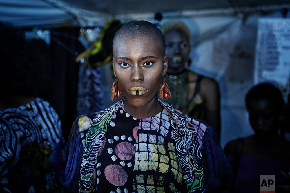 A models waits backstage during Dakar Fashion Week in the Senegalese capital, Friday June 30, 2017. (AP Photo/Finbarr O'Reilly)