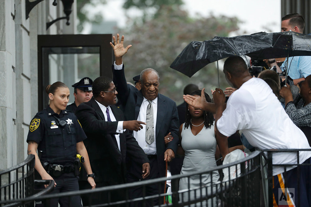 Bill Cosby, center, gestures while exiting the Montgomery County Courthouse with his publicist Andrew Wyatt, second from left, after a mistrial was declared in his sexual assault trial in Norristown, Pa., Saturday, June 17, 2017. Cosby's trial ended without a verdict after jurors failed to reach a unanimous decision. (AP Photo/Matt Slocum)
