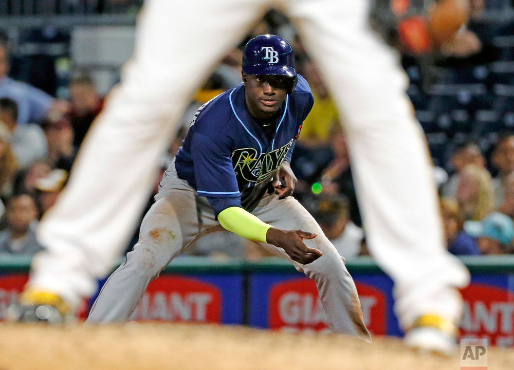 Tampa Bay Rays' Adeiny Hechavarria leads off first after his RBI single off Pittsburgh Pirates relief pitcher Juan Nicasio during the eighth inning of a baseball game in Pittsburgh, Tuesday, June 27, 2017. The Rays won in 10 innings 4-2. (AP Photo/Gene J. Puskar)