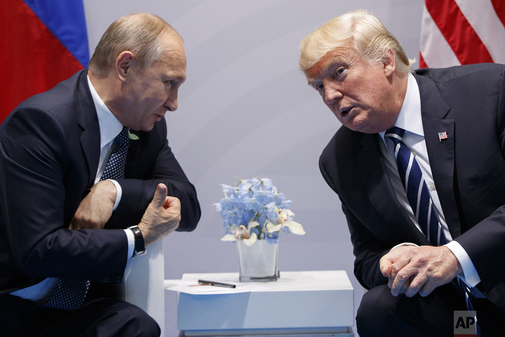 U.S. President Donald Trump meets with Russian President Vladimir Putin at the G-20 Summit, Friday, July 7, 2017, in Hamburg. (AP Photo/Evan Vucci)