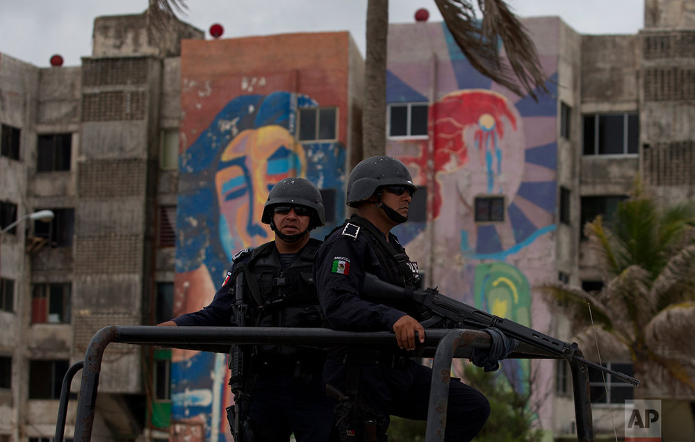 In this July 2, 2017 photo, Veracruz state police patrol along the waterfront boulevard in Coatzacoalcos, Mexico. (AP Photo/Rebecca Blackwell)