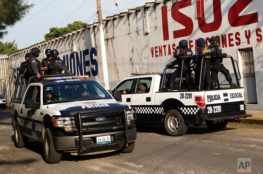 In this June 30, 2017 photo, Veracruz state police patrol in Coatzacoalcos, Mexico. (AP Photo/Rebecca Blackwell)