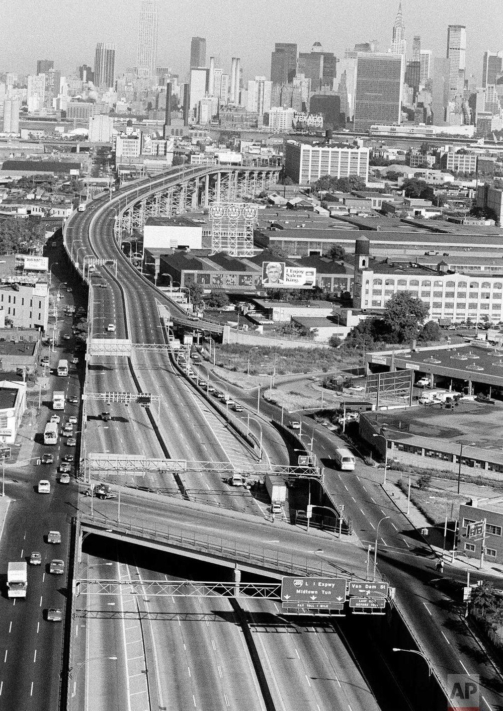 This is an aerial view from New York's borough of Queens, looking toward midtown Manhattan, showing a virtually deserted Long Island Expressway and entrance to the Midtown Tunnel, July 14, 1977, in the wake of last night's massive power failure. Tunnels to Manhattan were closed because ventilation fans were inoperable without electric power. (AP Photo/Dave Pickoff)
