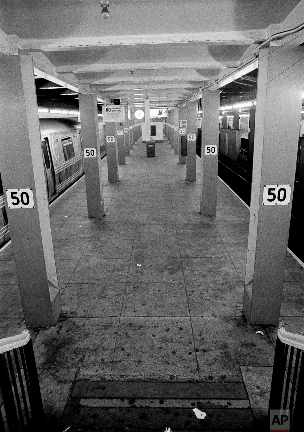 The subway platform at 50th Street under Rockefeller Center was empty of travelers at 5 P.M., July 14, 1977, when it would normally be jammed with rush hour commuters. Subway service in New York City was only partially restored by 5:30 P.M. in the aftermath of the massive power failure which hit the city last night, July 13. (AP Photo/Suzanne Vlamis)