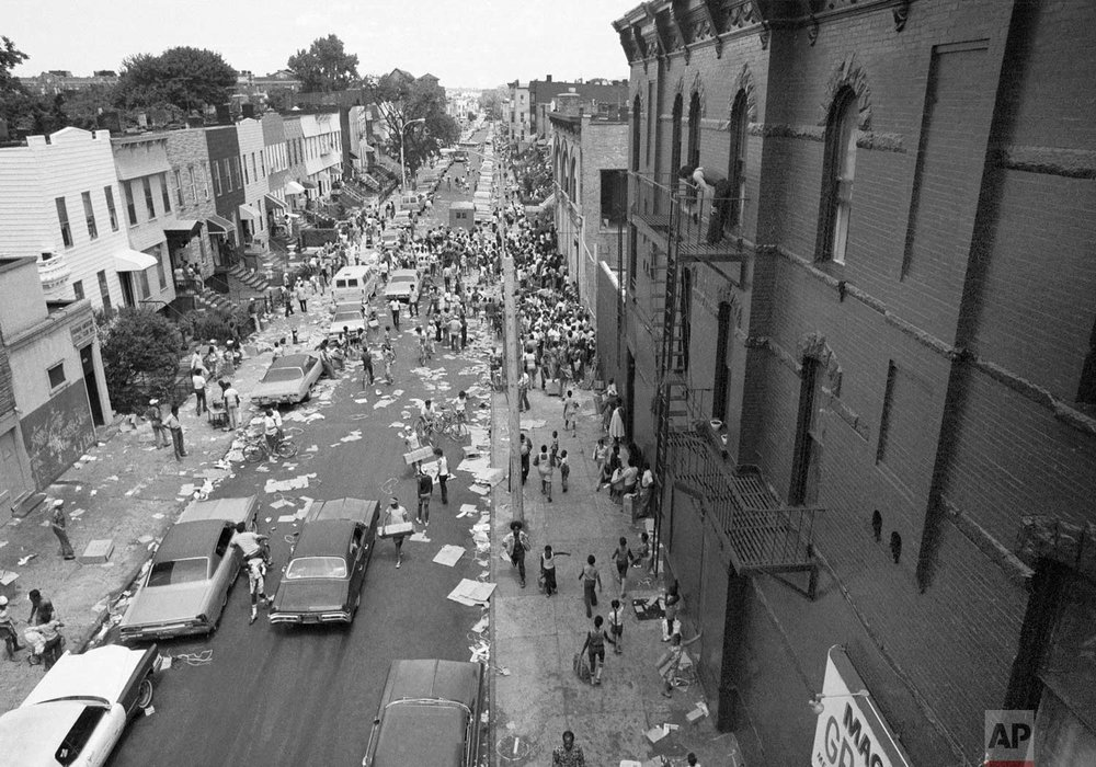 A street in the Bedford-Stuyvesant section of Brooklyn is full of people and debris, July 14, 1977 following last night's massive blackout in New York City. (AP Photo)