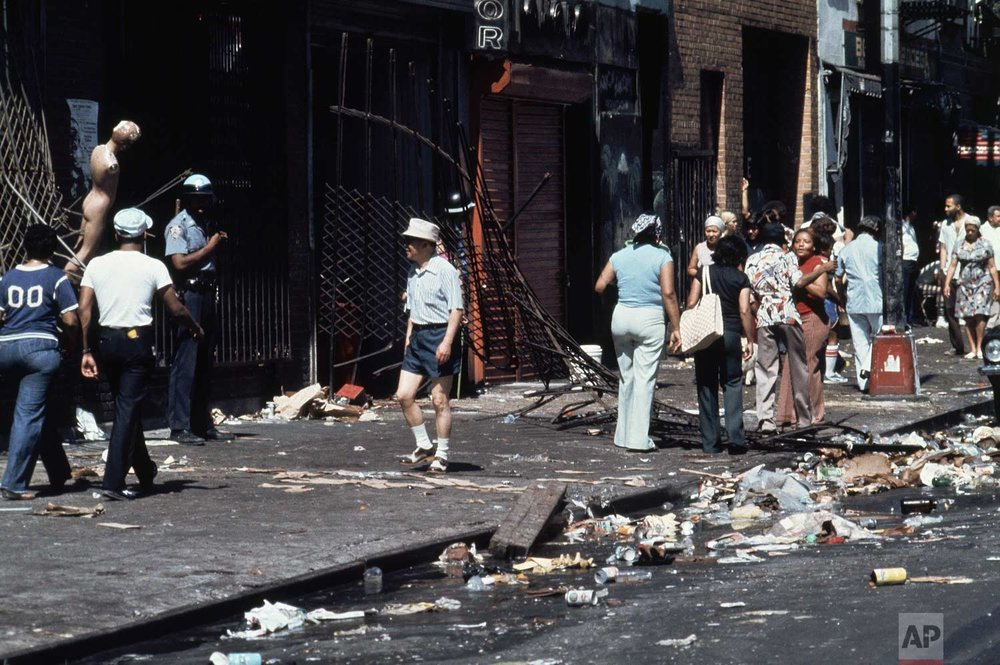 This is the aftermath of looting on 110th Street and Third Avenue in the East Harlem section of Manhattan, New York City during the power failure, July 14, 1977. (AP Photo/Ira Schwarz)