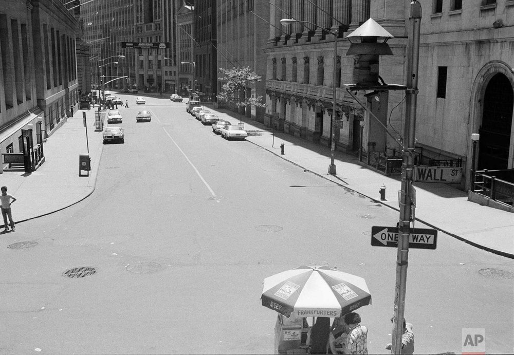 New York's Wall Street is deserted Thursday, July 14, 1977, after a massive power failure that lasted overnight from Wednesday forced the closing of the New York Stock Exchange.  (AP Photo)