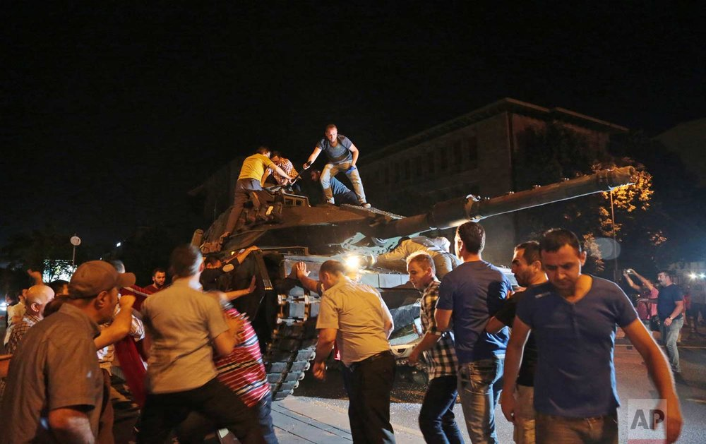 Tanks move into position in Ankara as people attempt to stop them. (AP Photo/Burhan Ozbilici)
