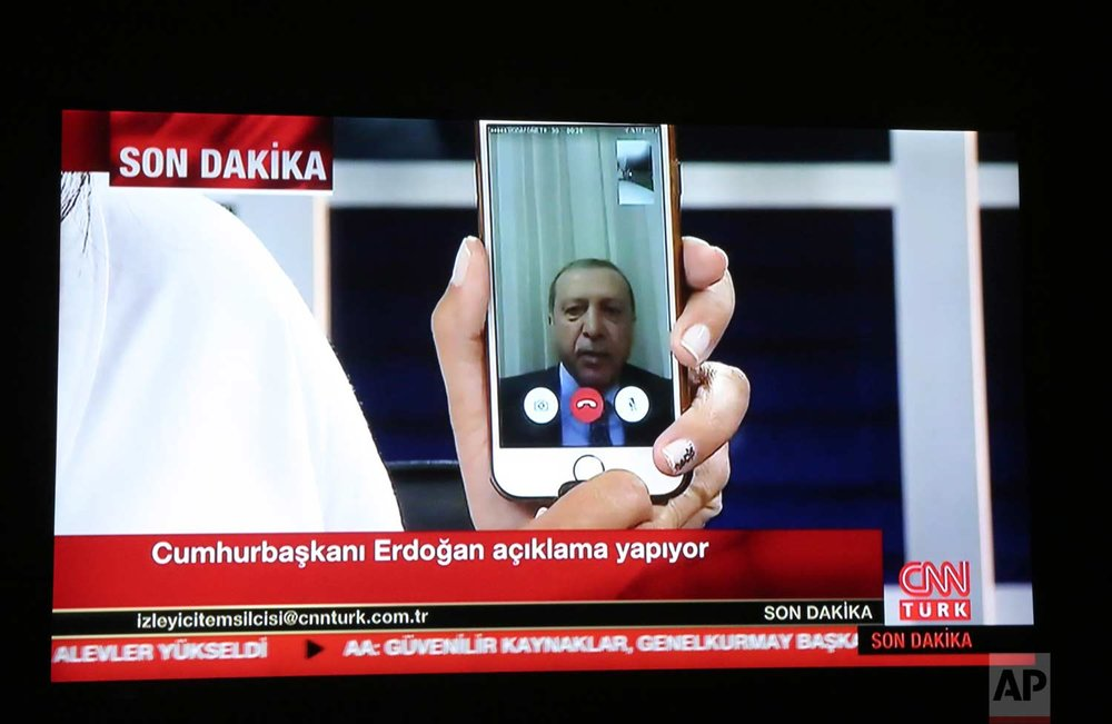A live broadcast shows Turkish President Recep Tayyip Erdogan addressing the nation from an undisclosed location via FaceTime. (Depo Photos via AP)