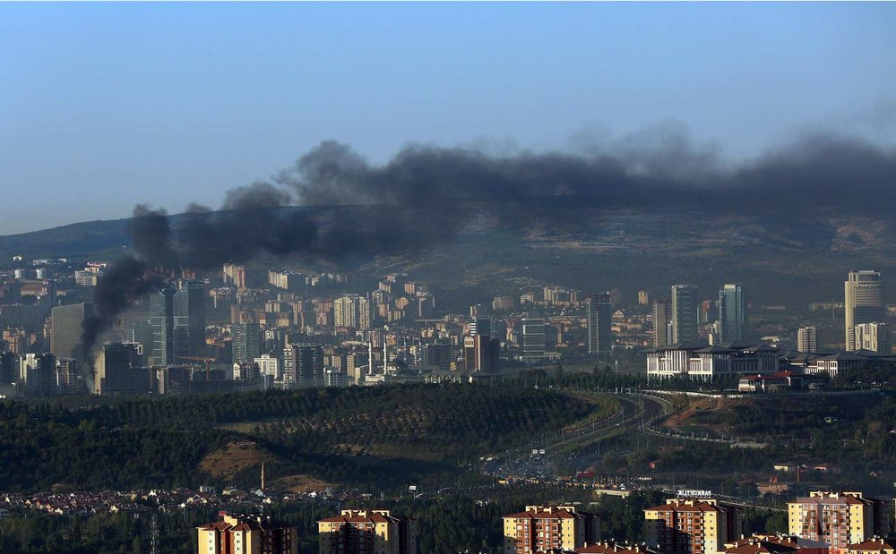 Smoke billows from an area near the Presidential Palace in Ankara. (AP Photo/Ali Unal)