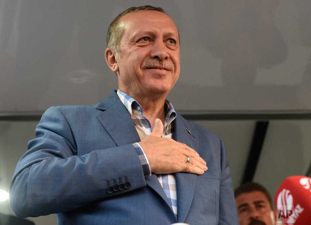 Erdogan delivering a speech in Istanbul after the coup attempt is over. (AP Photo)