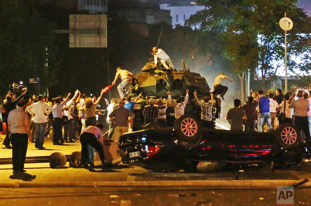 In this early Saturday, July 16, 2016 photo, tanks move into position as people attempt to stop them, in Ankara, Turkey, during the coup attempt. (AP Photo)
